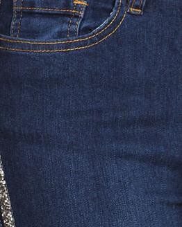 close up view of rhinestone trim of stripe jeans