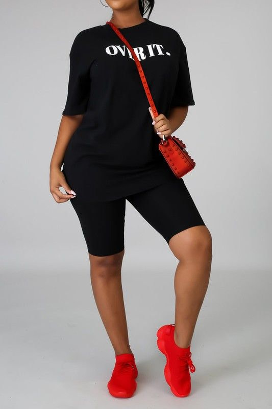 bike shorts set in black modeled with red bag and red sneakers
