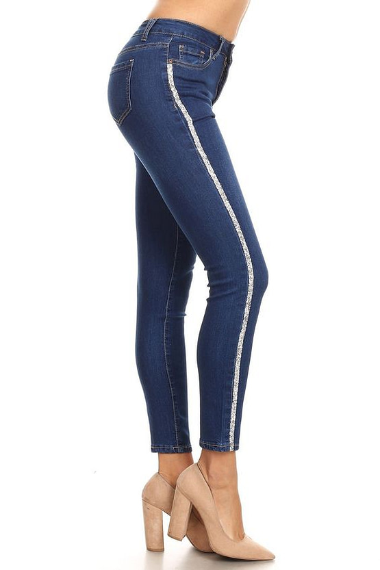 front view of model in medium washed blue stripe jeans with rhinestone trim