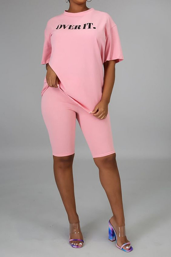 pink bike shorts set with 'OVER IT' printed on t shirt