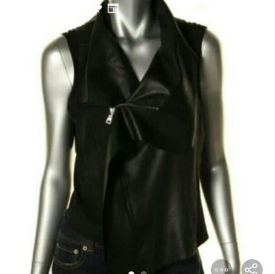mannequin display of a womens black faux leather top
