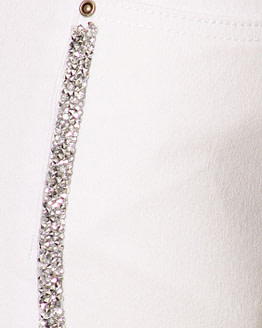 rhinestone jeans in white close up view of gems